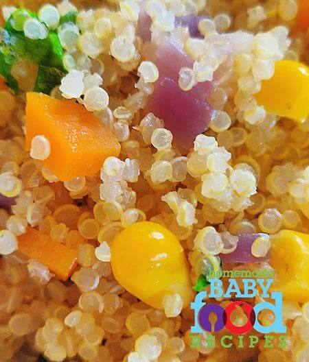 A close up of cooked quinoa and vegetables for babies