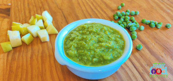 A bowl of pea and apple puree, with chopped apple and frozen peas